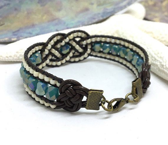 Josephine Knot Bracelet, Beaded Bracelet, Beaded Leather Cuff, Leather Knot Jewelry, Blue Bracelet, Boho Cuff, Celtic Knot Bracelet, Unique Featuring 6mm Aqua Blue Fire Polished beads and 8/0 Opaque Light Beige Luster seed beads handwoven onto brown leather cord with a beaded