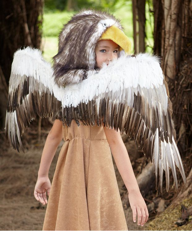 You put the regal in eagle with this girls costume! Glide along in this flattering faux suede dress with faux fur trim. Regal eagle costume for girls is imported.
