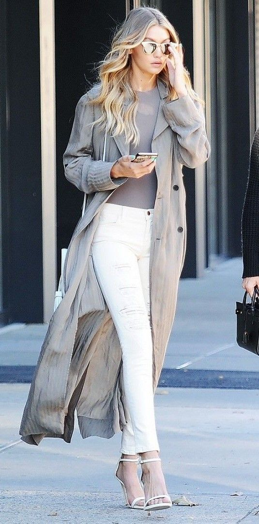 The Shoe Style That Goes With Every Single Outfit - Gigi Hadid wears distressed white jeans with a taupe trench and simple two-strap heels.