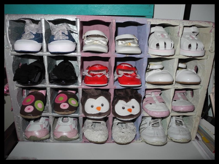 Old wooden crate repurposed as baby shoe storage