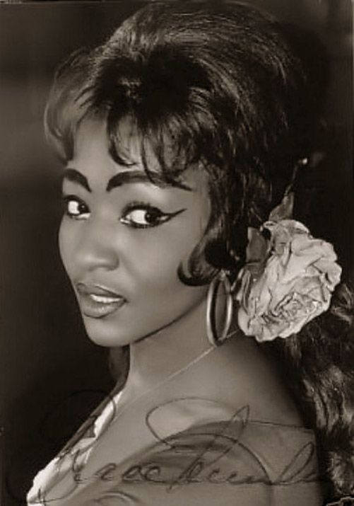 Grace Bumbry (born January 4, 1937), an American opera singer, is considered one of the leading mezzo-sopranos of her generation, as well as a major soprano for many years. She was a member of a pioneering generation of singers who followed Marian Anderson (including Leontyne Price, Martina Arroyo, Shirley Verrett and Reri Grist) in the world of classical music and paved the way for future African American opera and classical singers.