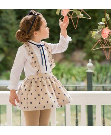 49fe96105 Conjunto para niña desde 2 años hasta 10 años. Camisa en blanco con botones  dorados