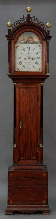 W. Cummens mahogany tall case clock, case with fret work top and three brass finials over tombstone glass, flanked by brass stop - Realized Price: $24,150.00