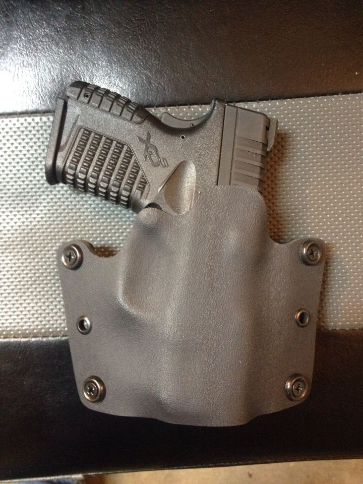 "OWB holster for Springfield XDs 45 in black kydex with 1.5"" belt loops."