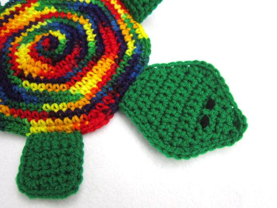Check out this item in my Etsy shop https://www.etsy.com/listing/112061297/crocheted-turtle-pot-holder-in-rainbow