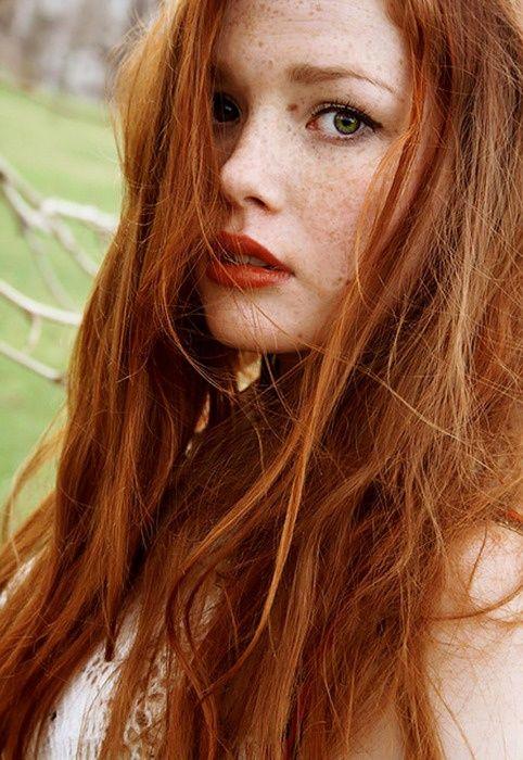 natural brow and skin, black mascara red lip.