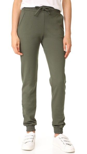 Get this Etienne Marcel's slim trousers now! Click for more details. Worldwide shipping. Etienne Marcel Army Pants: These slim Etienne Marcel pants are composed of soft, mid-weight jersey. Covered elastic waist and cuffs. Slant hip pockets. Drawstring tie. Fabric: Jersey. 67% rayon/29% nylon/4% spandex. Hand wash. Made in the USA. Measurements Rise: 11in / 28cm Inseam: 33in / 84cm Measurements from size 27 (pantalón slim, stretchy, hose im slim-stile, pantalón slim, pantalon slim…