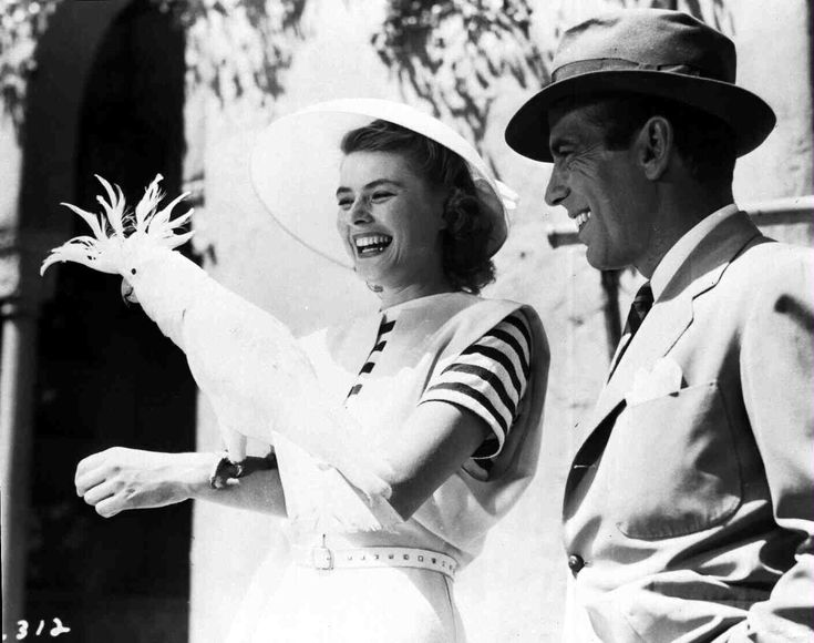 Casablanca   Medium BTS shot of Ingrid Bergman as Elsa Lund with bird on arm and Humphrey Bogart as Rick Blaine.