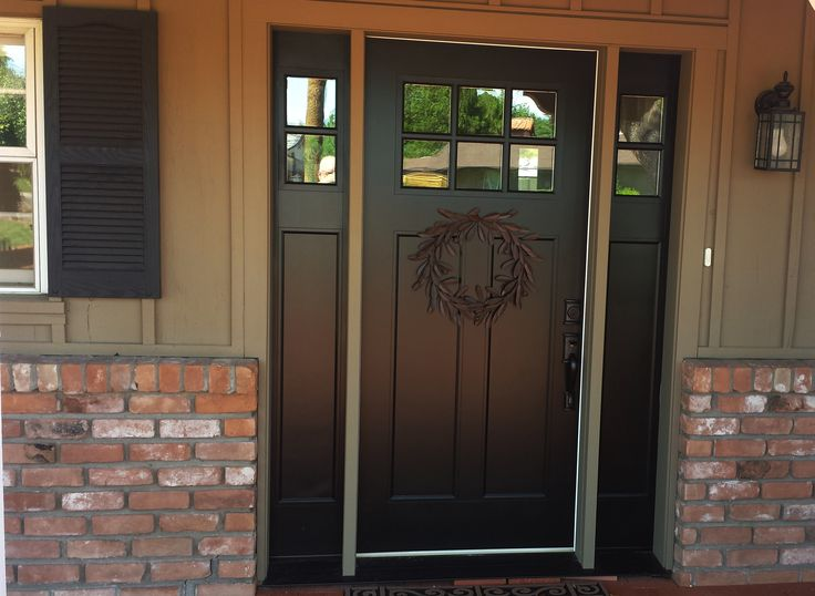 half glass entry doors with double side lights on cream painted wall combined with brick wall with black front door with sidelights plus sidelight window