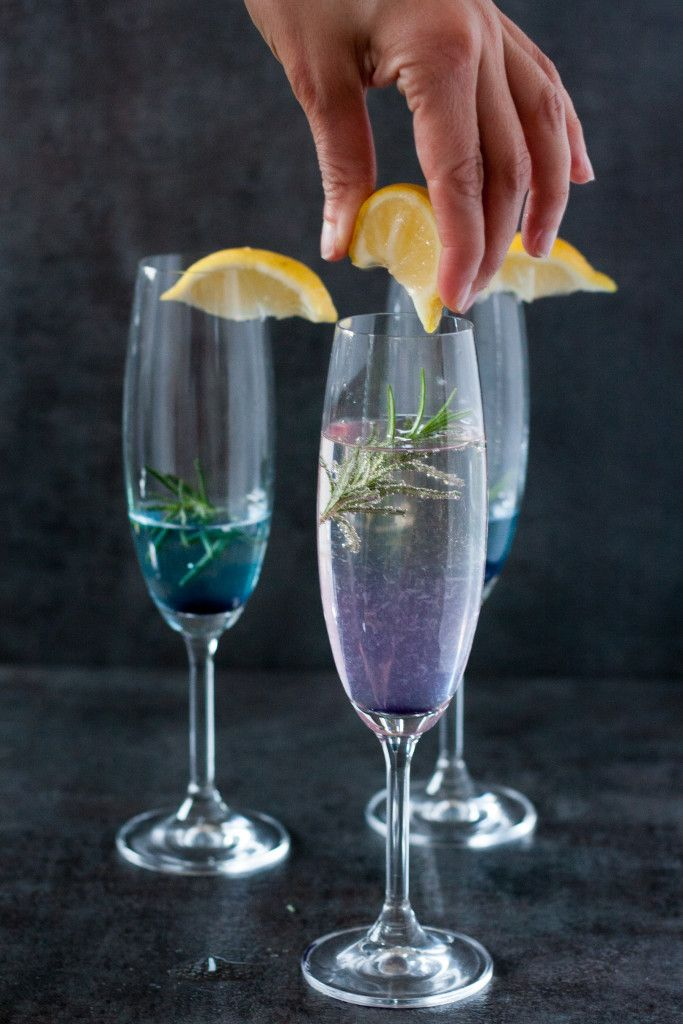 A refreshing New Year's Eve Cocktail! Get the *color changing* Rosemary 75 champagne cocktail recipe on GoodieGodmother.com  Also a great general wedding or party drink idea. ;)