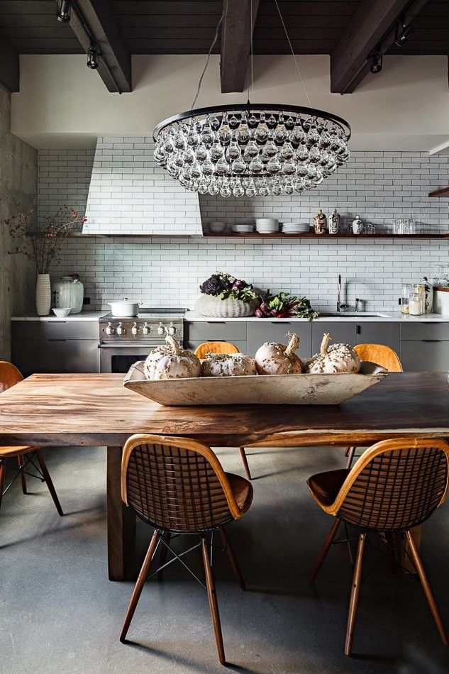 Jessica Helgerson Kitchen Arctic Pear Chandelier/Remodelista. Utility tiles, grey cupboards and wooden furniture make a great combination in this kitchen