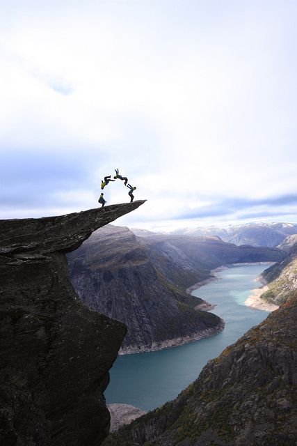Backflip on the Tip of Tongue. Trolltunga ('Troll's Tongue'), Norway // photo by Opplev Odda Hardanger