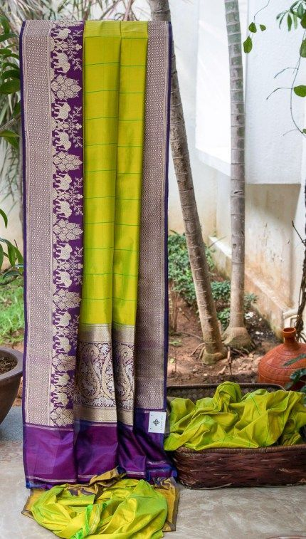 #pista green with light green stripes all over and purple designed border#