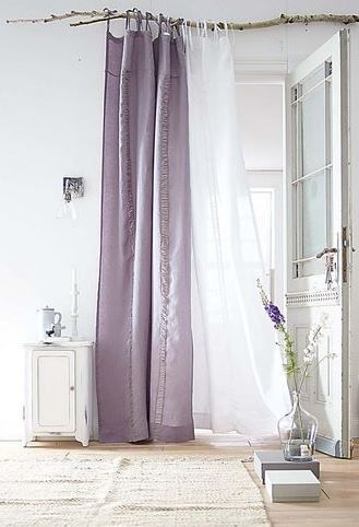 simple lavender curtain panel with branch 'pole'