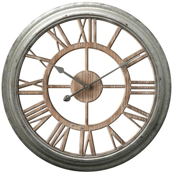 The Laurel Foundry Modern Farmhouse Wall Clock is a handsome oversized wall clock with hints of modern industrial designs. The antique zinc case surrounds the cut-out wood roman numerals. This wall clock offers decor and functionality.