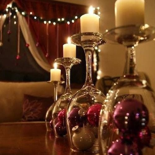 Turn wine glasses upside down, place a candle on top, and put some sort of ornaments underneath!