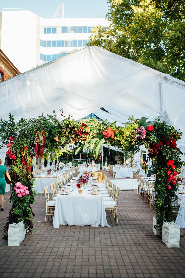 Floral Arch to mark the entrance to the marquee. New Years Eve wedding with Fuchsia, gold and white. Styled by www.cdweddings.com.au - photo by www.natasjakremersblog.com