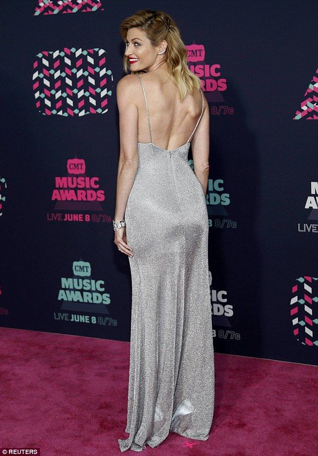 Erin Andrews stuns in silver dress as she hosts the CMT Music Awards
