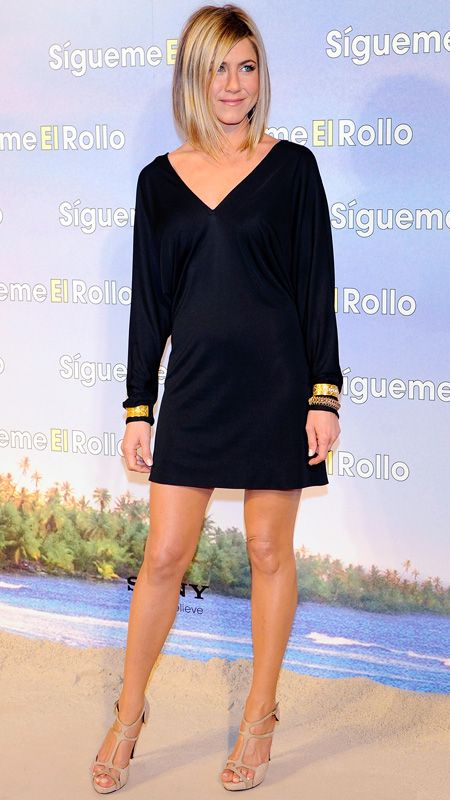 The actress added gilded gold cuffs to her long-sleeved frock for the Just Go With It Madrid premiere.