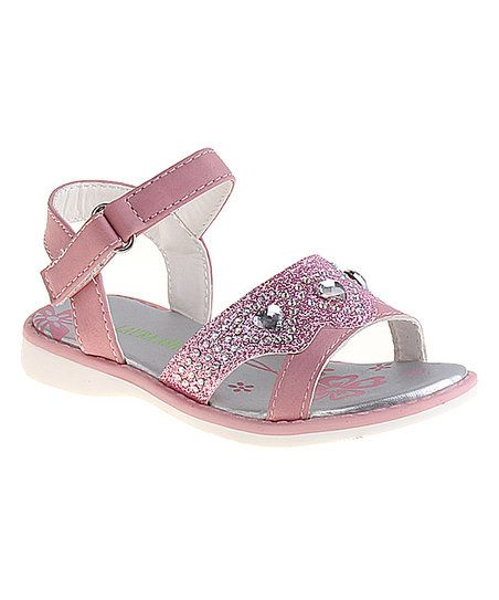 Add glimmer to your little one's look with this sandal, encrusted with glitter and sparkling crystals.
