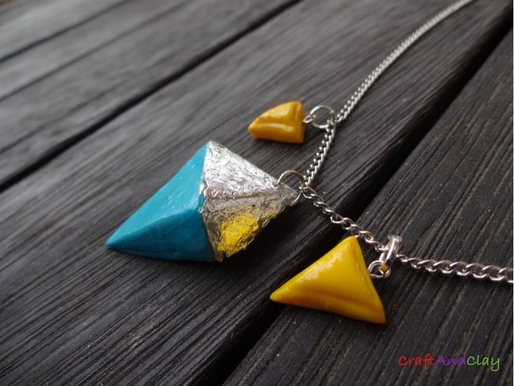 This is an edgy, modern piece of jewellery made by me out of polymer clay and craft foil. Would you like for this to become yours? You can find it here: https://www.etsy.com/au/shop/CraftAndClayUniverse?ref=hdr_shop_menu