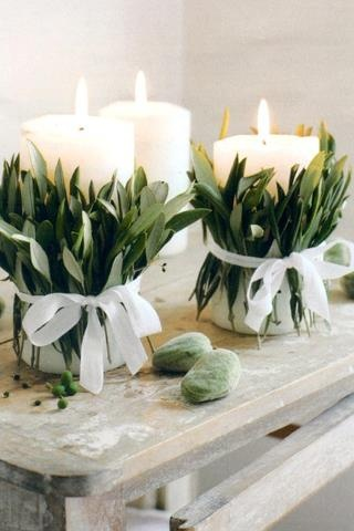 Christmas White Candles Wrapped with Leaves and Tied. I want to do this now!