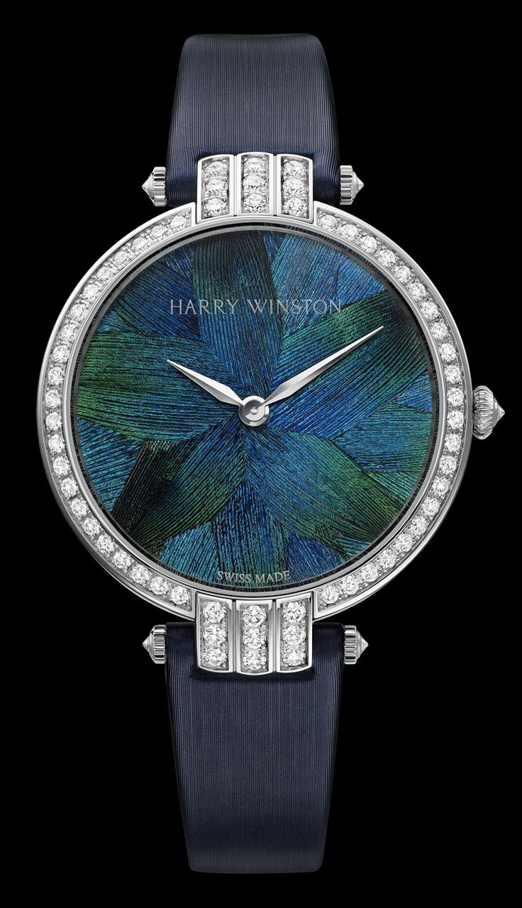 Harry Winston enlisted the talented hands of Nelly Saunier to make the uniquely feathered dials and ensure that the feathers themselves were ethically sourced from species raised specifically for this purpose, with great care taken to choose the perfect feathers. The feather dials then are combined with the Cluster, the three-dimensional technique invented by Harry Winston himself which allows for the asymmetrical setting of pear, brilliant, and marquise-cut stones.