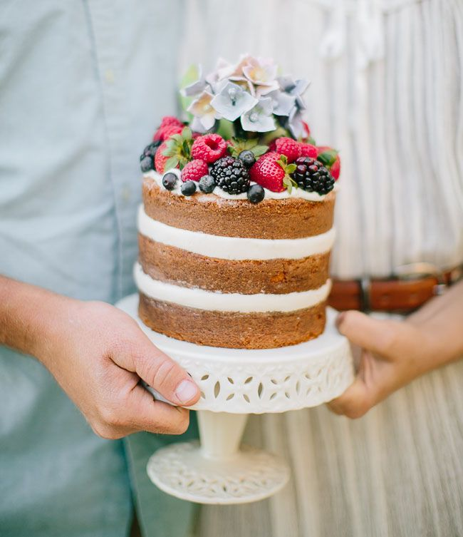 naked cake with red white and blue berries