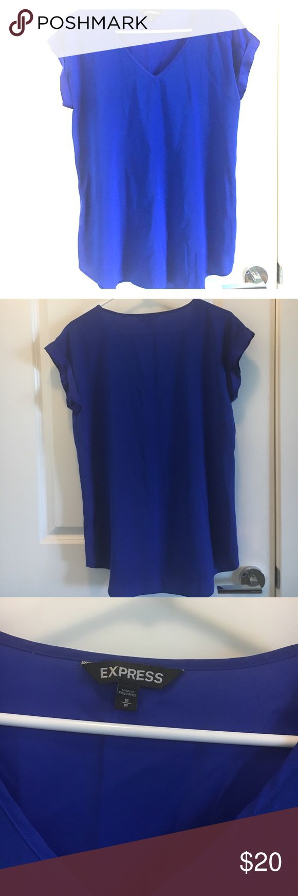 Royal blue blouse Beautiful blouse in royal blue. There is not much stretch the shirt. In great condition. From a smoke free home. Express Tops Blouses