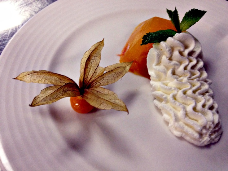 Oranges and grapefruit jelly with Cointreau, topped with homemade sambuca cream