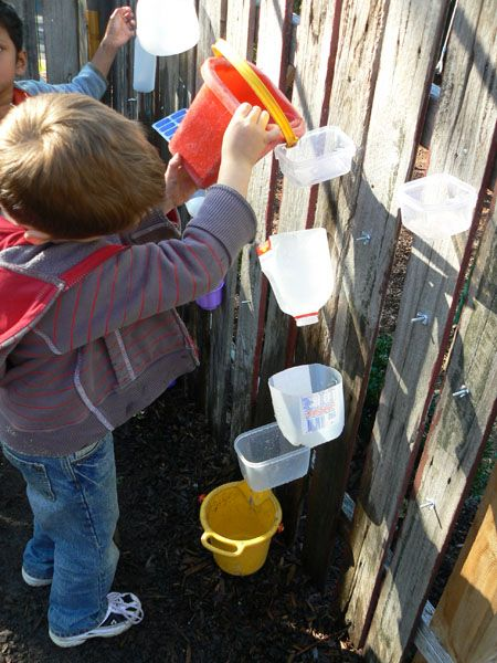 i really like this water wall example. they set it up for the children to move the containers to different places and experiment with water paths. perfect outdoor activity!