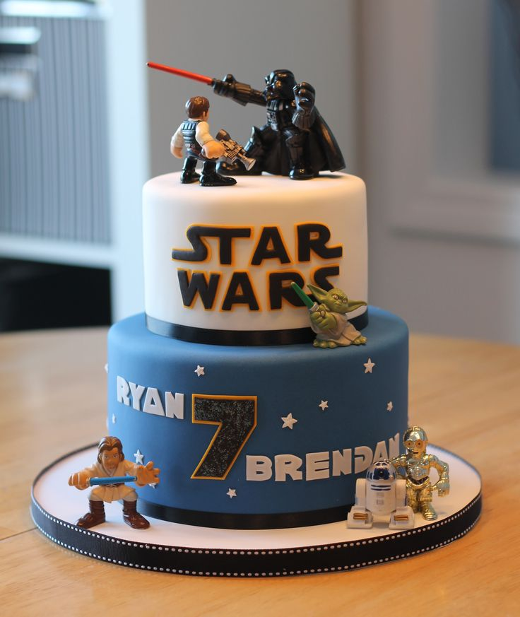Two-tier Star Wars themed birthday cake for twins Ryan & Brendan turning 7 this year.  Cake is decorated with hand-cut fondant accents and finished with licensed SW characters.