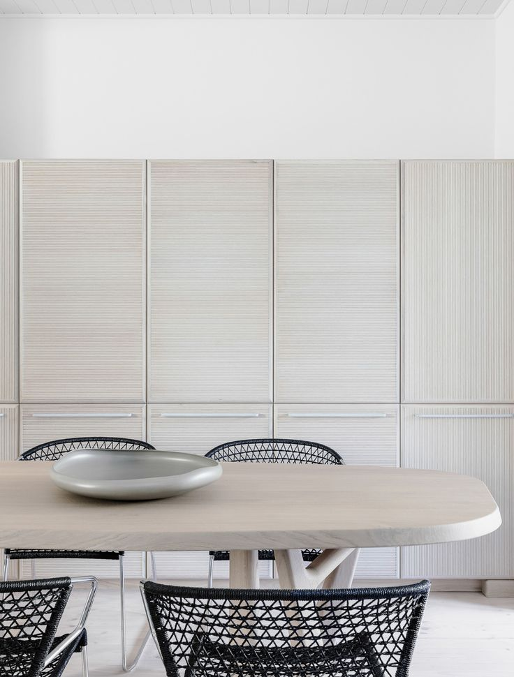 Redfern Terrace by Kirsten Stanisich of SJB Interiors | Yellowtrace  Ribbed veneer cupboards, with quad timber framing and pastel blue handles. Christophe Delcourt table in foreground.