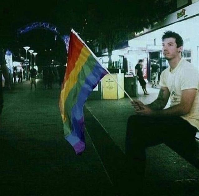 Josh dun with PRIDE FLAG