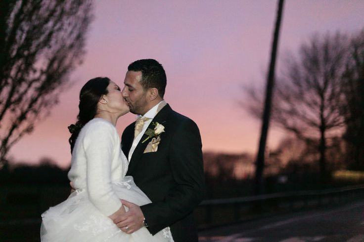 The happy couple kissing in a winters sunset