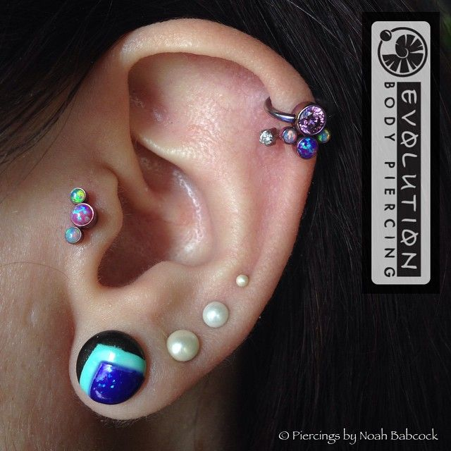 Helix and tragus piercings with opal and titanium jewelry ...