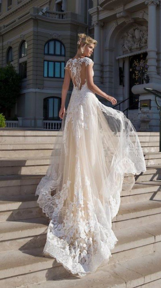 embroidered sheer back wedding dress with tulle overskirt via alessandra rinaudo