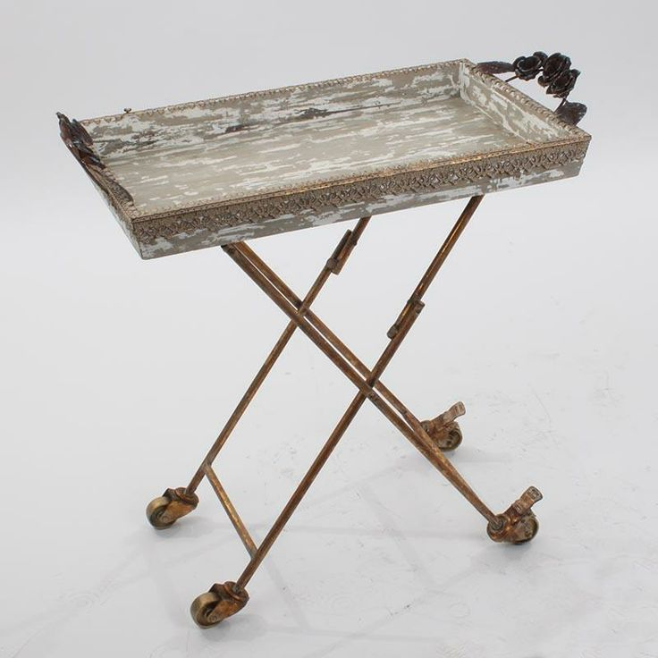 Wooden tray table in antique grey color and metal details in gold color.
