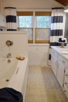 Shannon of Fox Hollow Cottage gave her bathroom a fresh, coastal look without renovating. The windows got a finishing touch with Blinds.com Woven Wood Shades.