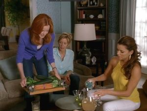 Marcia Cross serves crudite from Vagabond House's Pear Branch Hardwood Tray on the set of Desperate Housewives