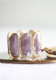 I need another purple bracelet like I need a hole in the head.