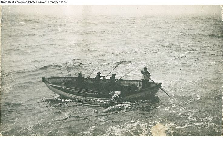 Body of Titanic victim being picked up at sea