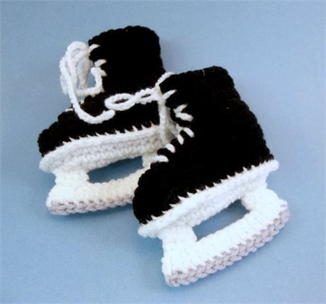Hockey skates for your baby!! These black and white acrylic booties are crochet to fit your baby of approx. 6 months of age.   The sole length of the booties is 4.   If you would like these booties made in a different size or color combination, please message me.