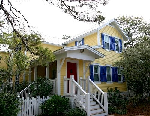 Modern house decorating design ideas yellow house blue shutters color for livingroom for Exterior paint yellow
