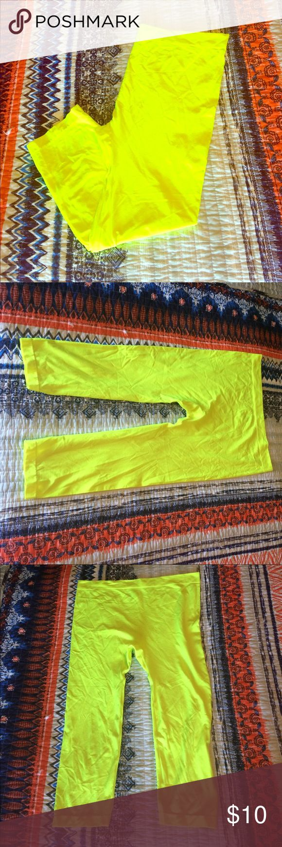 NWOT neon yellow Capri leggings NWOT never worn neon yellow Capri leggings are super stretchy light and comfortable. Can fit from a larger medium all the way to a 2X. Dots Pants Capris