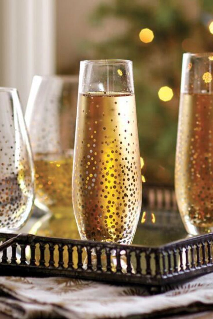toast the new year in style with these gold and silver confetti wine glasses from world