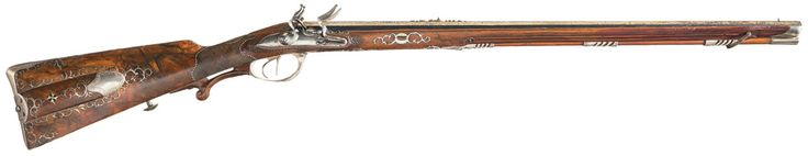 Ornate double barrel flintlock rifle crafted by Chretien Koerber, court gunmaker for the Prince zu Hohenlohe and the Duke of Wurttemberg from the mid to late 19th century. Estimated Value: $20,000 - $30,000