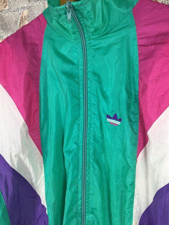 Vintage ADIDAS Jacket Men/Women Medium 90s Adidas Three Stripes Sportswear Adidas Trefoil Multicolour Windbreaker Adidas Trainer Size M Tag reads: Size M (check measurements below) Measurements: Width (armpit to armpit): 21.5 Length (shoulder to end of garment): 25 All