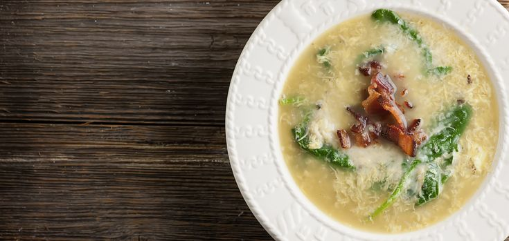 Turn everyone's favorite breakfast into lunch with this easy recipe for bacon and egg soup!  With a little spinach and cheese in the mix as well.