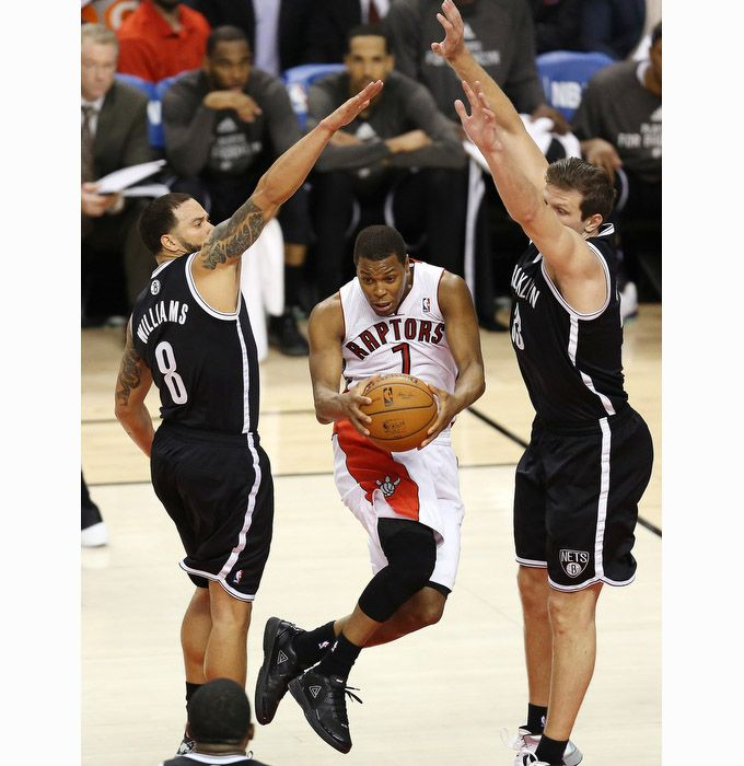 Kyle Lowry sails between a pair of defenders. #Raptors #wethenorth #Toronto